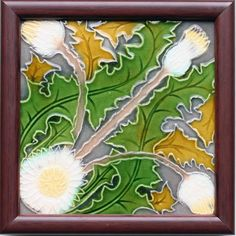 An Art Nouveau partial-relief tile featuring thistle heads, stems, and leaves in white, yellow, grey and olive on a mid...