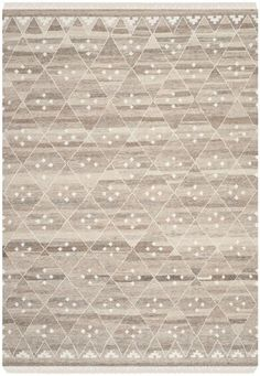 NKM316B Rug from Kilim collection.  A stylized compilation of ages-old nomadic tribal motifs, Natural Kilim rugs are hand-woven by artisans of hand-carded wool for rich, lustrous texture. Rus