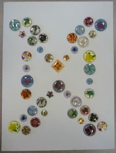 Assortment of plastic buttons with flower, lace and other designs.