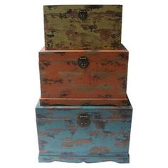 Set of three weathered wood trunks.Product: Small, medium and large trunkConstruction Material: WoodColor: Blue, green and orangeFeatures: Warmly weathered charm  Dimensions: 17 H x 26 W (large)