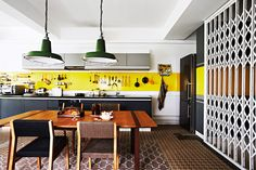 The loft-style open kitchen and dining area serve the couple's lifestyle well, as they often host brunch for friends on the weekends. By WY-TO