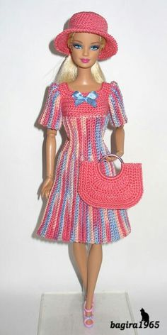 knitting dress for barbie At this time I wish to present you among the garments that I knit for Barbie dolls. Barbie Clothes Patterns, Crochet Barbie Clothes, Doll Clothes Barbie, Barbie Doll, Dress Barbie, Barbie Knitting Patterns, Barbie Wardrobe, Crochet Doll Dress, Barbie Collection