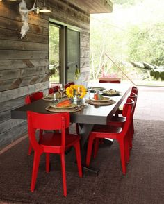 Feast Your Eyes: Gorgeous Dining Room Decorating Ideas - The bright-red chairs in this room make a bold statement that really draws your attention to the table.
