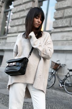Outfit - Wide and comfy. Nisi is wearing: White wide-leg pants, oversized knit sweater, Proenza Schouler PS11 Mini Classic Bag, Hermès Oran sandals - teetharejade.com