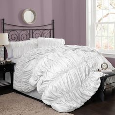Create a romantic vibe in the bedroom with this four-piece white comforter set. It features an eye-catching gathered design and is crafted from 100 percent polyester. This set includes everything needed for a complete look, including the bed skirt.