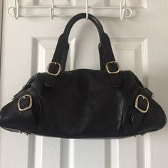 Burberry Black leather satchel bag Authentic Black leather satchel bag from Burberry. Used and in good condition. Price is negotiable for serious buyers. No Trades! Burberry Bags Satchels