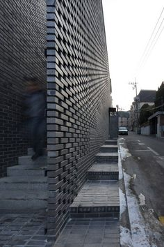 Perforated brick walls front this Seoul office block by Wise Architecture, flanking staircases that lead up to a rooftop terrace with views of a nearby historic park (+ slideshow). Known as the ABC B