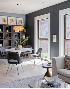 Dark grey walls with yellow/orange. Modern decor.