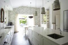 Clean, white kitchen. Interesting galvanized lighting fixtures.