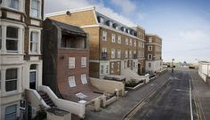 Alex Chinneck - FROM THE KNEES OF MY NOSE TO THE BELLY OF MY TOES