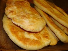 Naan Bread. I love it with Some minced garlic added. They can be cooked like tortillas on an oiled surface instead of baked, too.