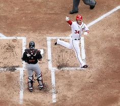 Bryce Harper...one day I will figure out why he flashes that sign when he gets home runs haha