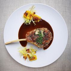 """Gayle Van Wely Quan (@gayleq) on Instagram: """"Herbed Veal Chop in Madeira Sauce with charred garlic corn and frisée #foodstarz_official #fit…"""""""