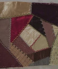 An authentic antique Victorian Crazy Quilt block. Fabrics are an interesting mixture of silks and satins with brocades and prints. The block is embroidered with turkey tracks as shown. I'm selling a s                                                                                                                                                     More