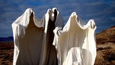 Ghosts. Bend an old wire coat hanger and drape an old, white bed sheet over it. Hang it from a tree or attach to stake to place out in the yard.