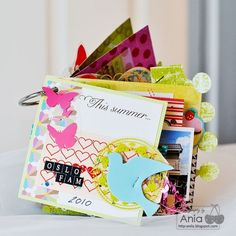 this blog has great mini book ideas.  I can't wait to scap my little heart out this winter!