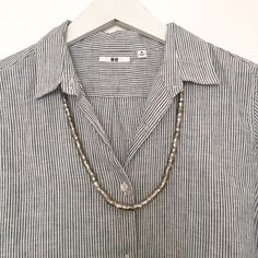 Uniqlo Linen Pin Stripe Shirt 100% linen dark blue & white pin stripe button down shirt with curved hem. Only worn a couple of times, excellent condition. UNIQLO Tops Button Down Shirts