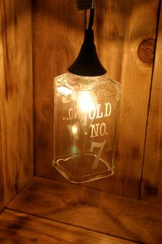 Old No. 7 Hanging Pendant Lamp made from an upcycled Jack Daniels 1 Liter Bottle. $69.00, via Etsy.
