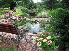 Don't have a view? Create one! This garden bench affords a peaceful place to relax amid perennials, roses and container gardens. Posted by gardenqueen5 - Our Favorite Garden Ponds From Rate My Space on HGTV