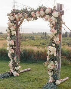A floral arch anchored this outdoor ceremony