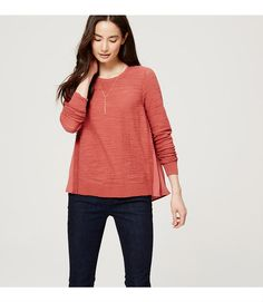 Play with texture by slipping into this subtle-yet-standout piece, finished with a fluid woven back. Round neck. Long sleeves. Shirred beneath back yoke. Ribbed neckline, cuffs and hem.