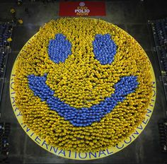 Members of the Rotary International Convention 2012 gather to form the world's biggest smiley during in Bangkok.