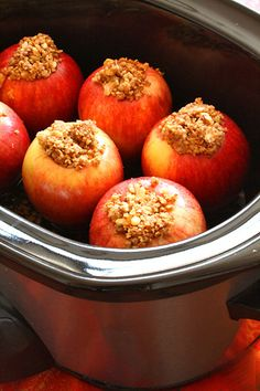 Crock-Pot Baked Apples - cored and stuffed with walnuts, brown sugar, coconut oil, cinnamon, apple cider.