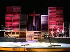 Pallet wall but spray words on possibly. Like this stage set up with raised drums etc Youth Group Rooms, Infinity Room, Altar, Rustic Cross, Church Stage Design, Rustic Backdrop, Pallet Walls, Stage Set, Stage Lighting