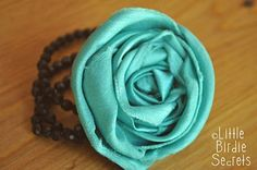 fabric flowers with velcro back so you can add them to bracelets...or whatever!