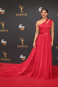 Priyanka Chopra at the Emmy Awards 2016 wearing a stunning one-shoulder red Jason Wu gown.