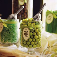 Green and White Candy Wedding Favors . Along with a green- and white-candy bar, a favor table was set up so guests could help themselves to boxes of green tea and green-frosted minicupcakes personalized with the monogram from Baby Cakes of Los Angeles.
