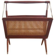 Foldable 1960's newspaper rack attributed to Ercolani | From a unique collection of antique and modern magazine racks and stands at https://www.1stdibs.com/furniture/more-furniture-collectibles/magazine-racks-stands/