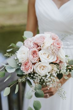 Beautiful blush and cream rose bouquet complete with carnations, silver dollar eucalyptus greenery, and baby's breath for an extra special touch. A perfect soft and subtle palette for the classic, feminine bride. Beautiful bridal portraits done in New Hill, North Carolina outside of Raleigh. Photo by Charlotte, North Carolina Wedding Photographer Kevyn Dixon.
