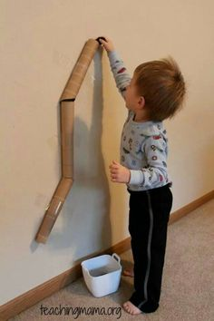 Tape paper towel or toilet paper rolls to the wall (or off furntiure) to make a tunnel. Give the lil ones a marble or small ball (IF you are watching them or are old enough that you know they wont put it in their mouth) and let them drop it into the top and wait for it to roll out.... Feeling crafty? Add extra ones at the end pointing in different directions so they don't know where it will come out at!