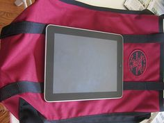 http://www.howtogetcheapairlinetickets.net/carry-on-restrictions.html Carry on luggage restrictions for all airlines. iPad on top of Red Oxx