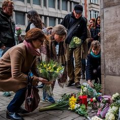 Mourners placed flowers outside the closed Maalbeek metro station in central Brussels where an explosion killed about 20 people on Tuesday. The subway station is near many European Union buildings including the European Parliament. Belgian investigators are racing to assemble a fuller portrait of the brothers who  along with at least 2 accomplices  carried out bombings at the subway station and at the airport that left 31 people dead and 300 wounded. The photographer @danielberehulak who…