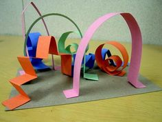 3d paper sculpture: kids will glue strips of construction paper on a piece of cardstock or cardboard