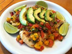 This Chicken with Mango Salsa and Avocados recipe is bursting with fresh flavors!  Plus, it is a very healthy chicken recipe to make for dinner.  Enjoy with a glass of white wine or your favorite tropical cocktail.