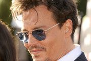 """Executive producer/actor Johnny Depp arrives at the premiere of Walt Disney Pictures' """"The Lone Ranger"""" at Disney California Adventure Park on June 22, 2013 in Anaheim, California."""