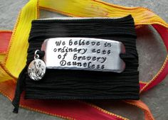 Hand Stamped Divergent Faction Bracelet - Dauntless on 100% Silk Ribbon with Fire Charm on Etsy, $22.00