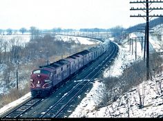 """After leaving its last stop at Topeka, Ks. with three E7s, Rock Island's Train 4 Golden State Limited is eastbound passing by """"Calhoun Bluffs"""" on Union Pacific trackage rights en route Kansas City. A cold and slightly foggy Feb. 18, 1967. Rock Island EMD E7(A) at Topeka, Kansas by Steve Patterson"""