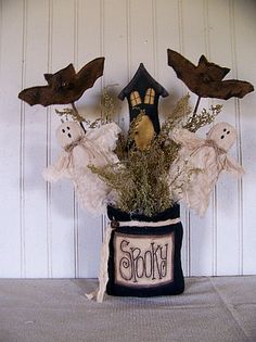 """Grungy Primitive Halloween """"Spooky"""" Bag with Ghosts, Bats & Haunted House. $24.99, via Etsy."""