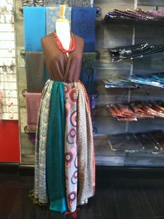 Scarf display. This mannequin's dress is made entirely out of Pashmina scarfs. We have a large selection for only $12.00 each