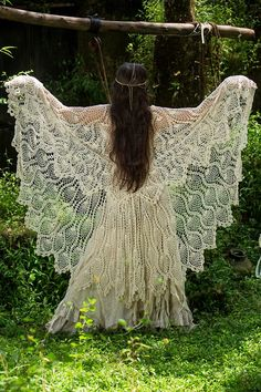 I just want to fly away I this amazing dress.  Perfect for releasing my inner hippy x......THAT LOOKS LIKE A TABLE CLOTH FOLDED OVER THE SHOULDERS