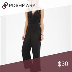 Black jumpsuit Super chic black jumpsuit. Peek a boo lace on front. Zips in the back. Forever 21 Dresses