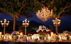 Ah outdoor chandeliers. They can add the elegance of a cathedral to any back yard garden.