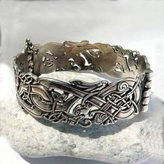 """Bracelet """"Celtic Dogs / Celtic Wolves"""". Bracelet with Celtic ornament elements and embellishments with wild dogs. by RuyaN on Etsy https://www.etsy.com/listing/226287811/bracelet-celtic-dogs-celtic-wolves"""