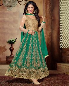 Sea green and golden lehenga cum anarkali suit with resham embroidery   1. Sea green and golden banglori silk lehenga cum suit2. Resham paisley embroidery with heavy golden embellished yoke/blouse3. Comes with matching santoon bottom and chiffon dupatta4. Can be stitched upto size 42 inches 5. It can be wear as beige and blue in both style
