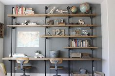 Home office and desk area with homemade wood/pipe shelves. Wood And Pipe Shelves, Wood Shelf, Wooden Shelves, Iron Pipe Shelves, Plumbing Pipe Shelves, Wood Wall, Industrial Shelving, Diy Shelving, Industrial Chic