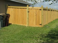 Capped board on board wood privacy fence by Mossy Oak Fence.